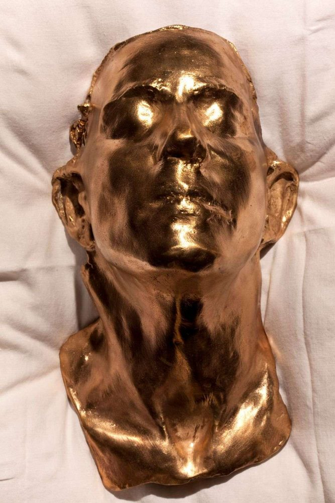 Ambivalence - Death mask, polished bronze, 45 x 17 x 13cm