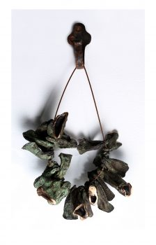 Ambivalence - Mother (aubergine necklace), bronze with patina (24 pieces), 30 x 23cm